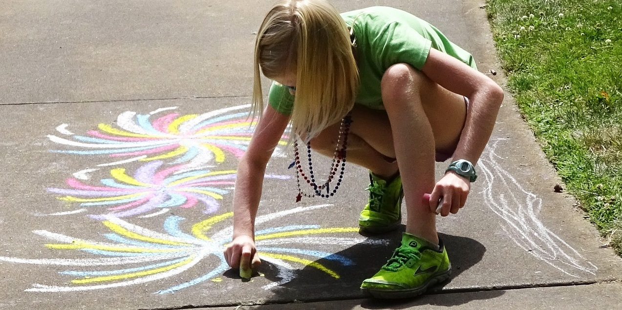 Child playing, sidewalk chalk